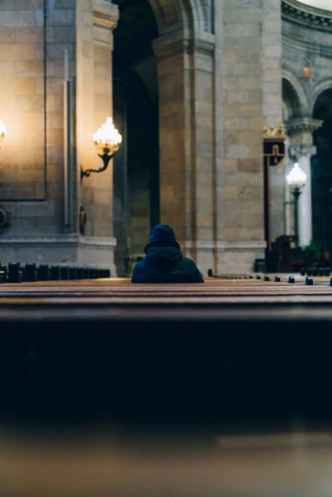 person sitting inside church